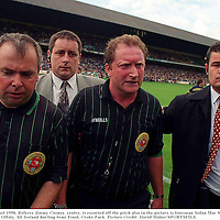 22 August 1998, Referee Jimmy Cooney, centre, is escorted off the pitch also in the picture is linesman Aidan Mac Sweeney, Left. Clare v Offaly, All Ireland hurling Semi Final, Croke Park. Picture Credit: David Maher/SPORTSFILE