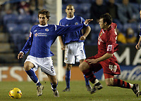 Photo: Jonathan Butler.<br />Leicester City v Cardiff City. Coca Cola Championship. 23/12/2006.<br />Gareth Williams of Leicester tries to avoid the incoming tackle from Darcy Blake of Cardiff