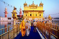 Sikhs approaching the Golden Temple (holiest Sikh shrine), Amritsar, Punjab, India