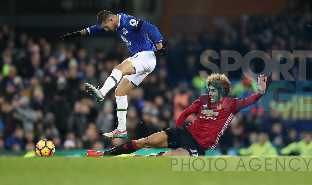 Kevin Mirallas of Everton and Marouane Fellaini of Manchester United during the Premier League match at Goodison Park, Liverpool. Picture date: December 4th, 2016.Photo credit should read: Lynne Cameron/Sportimage