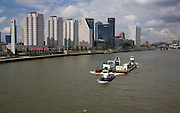 River transport and apartment blocks at Boompjes, River Maas waterfront area of central Rotterdam, Netherlands