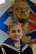 Kronstadt, Russia, 21/02/2004..11 year old Ivan Mishukov is a student at the Naval Kadetskii Korpus, the school of the elite Kronstadt Naval Academy. Abandoned by his alcoholic parents at the age of 3, Ivan lived for 2 years with a pack of wild dogs in his home town of Reutov before being rescued by police and taken to a children's home; he was subsequently adopted by Tatiana Bababina..Ivan with the school's bust of Peter the Great, founder of the Russian Navy.