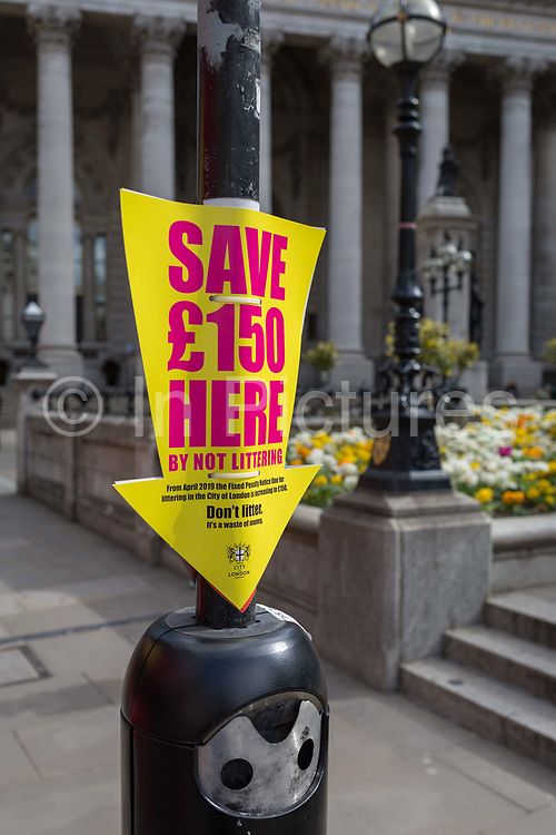 A warning of £150 fines for those caught littering in the streets of the City of London, the capitals financial district, on 25th March 2019, in London, England.