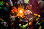 "Hindu's celebrate Holi in the Banke Bihari Temple in Vrindavan, in the Mathura district of Uttar Pradesh, India ,28th February 2010. <br /> <br /> Holi, also called the Festival of Colours, is a spring festival celebrated by Hindus, Buddhists, Sikhs, Jains and others. It is primarily observed in India, Nepal, Srilanka, Pakistan, Bangladesh, and countries with a large Indian diaspora populations, such as Suriname, Guyana, South Africa, Trinidad, UK, USA, Mauritius, and Fiji. In West Bengal of India and Bangladesh it is known as Dolyatra (Doul Jatra) or Basanta-Utsav (""spring festival""). The most celebrated Holi is that of the Braj region, in locations connected to the god Krishna: Mathura, Vrindavan, Nandagaon, and Barsana. These places have become tourist destinations during the festive season of Holi, which lasts here to up to sixteen days.<br /> The main day, Holi, also known as Dhulheti, Dhulandi or Dhulendi, is celebrated by people throwing colored powder and colored water at each other. Bonfires are lit the day before, also known as Holika Dahan (burning of Holika) or Chhoti Holi (little Holi). The bonfires are lit in memory of the miraculous escape that young Prahlad accomplished when Demoness Holika, sister of Hiranyakashipu, carried him into the fire. Holika was burnt but Prahlad, a staunch devotee of god Vishnu, escaped without any injuries due to his unshakable devotion. Holika Dahan is referred to as Kama Dahanam in Andhra Pradesh.<br /> <br /> PHOTOGRAPH BY AND COPYRIGHT OF SIMON DE TREY-WHITE<br /> <br /> + 91 98103 99809<br /> + 91 11 435 06980<br /> +44 07966 405896<br /> +44 1963 220 745<br /> email: simon@simondetreywhite.com photographer in delhi photographer in delhi photographer in delhi"