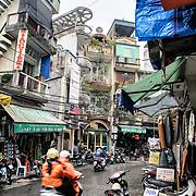 A street in a market district of Hanoi, Vietnam.