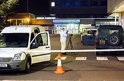 © Licensed to London News Pictures. 26/09/2018. Basildon, UK. Police forensics examine a vehicle at the scene at Basildon Hospital in Essex where a 19 year old male was take  after being shot in Tilbury earlier this evening. The male is being treated for a gunshot wound to the stomach and is currently in a serious condition. Photo Credit: Simon Ford/LNP