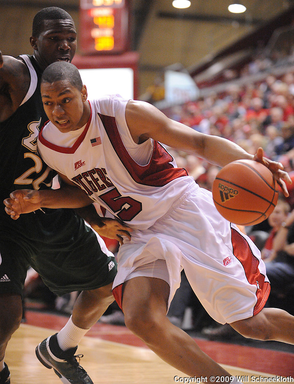 Mar 7, 2009; Piscataway, NJ, USA; Rutgers forward J.R. Inman (15) drives to the basket against South Florida guard Dominique Jones (20) during the second half of Rutgers' senior day game against South Florida at the Louis Brown Athletic Center.  Rutgers won 45-42.