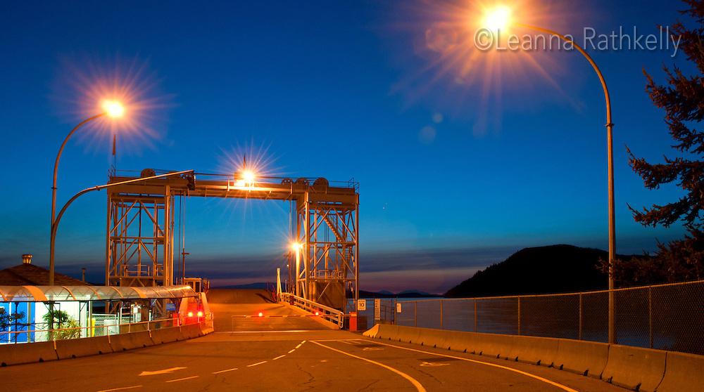 Twilight falls on the ferry dock at Village Bay, Mayne Island, BC Canada