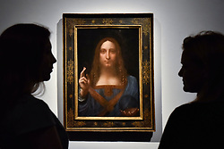 "FILE PICTURE © Licensed to London News Pictures. 24/10/2017. LONDON, UK.  Staff members view ""Salvator Mundi"", c1500, by Leonardo da Vinci at a photocall at Christie's in London.  The artwork is the last Da Vinci painting in private hands and was offered for sale by Christie's in New York on 15 November with an estimate in the region of US$100m, but eventually sold for $450m including buyer's premium.  Photo credit: Stephen Chung/LNP"