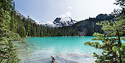 At Middle Joffre Lake, see Matier Glacier (left) and Stonecrop Glacier on Slalok Mountain (right) in Joffre Lakes Provincial Park of British Columbia, near Pemberton, in the Coast Range, Canada. A rough, rocky, steep hike of 10 kilometers round trip ascends (400 meters up) by a rushing stream to three beautiful turquoise lakes (colored by glacial silt reflecting green and blue sunlight). This panorama was stitched from 5 overlapping photos.