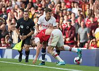 Football - 2019 / 2020 Premier League - Arsenal vs. Tottenham Hotspur<br /> <br /> Tempers flare as Sokratis Papastathopoulos (Arsenal FC)and Harry Winks (Tottenham FC)  clash at The Emirates.<br /> <br /> COLORSPORT/DANIEL BEARHAM