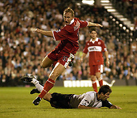 Picture: Henry Browne.<br />Date: 25/08/2004.<br />Fulham v Middlesborough FA Barclays Premiership.<br /><br />Ray Parlour of Borough skips over a challenge from Fulham's Carlos Bocanegra