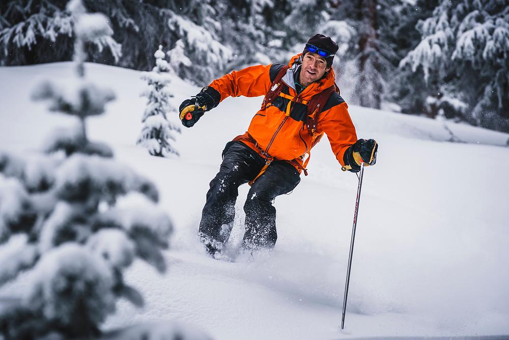 Owner of the Mount Hayden Backcountry Lodge Eric Johnson having fun in the trees, San Juan Range, Colorado.