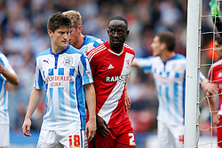 Joe Lolley of Huddersfield and Albert Adomah of Middlesbrough jostle at a Middlesbrough corner - Photo mandatory by-line: Rogan Thomson/JMP - 07966 386802 - 13/09/2014 - SPORT - FOOTBALL - Huddersfield, England - The John Smith's Stadium - Huddersfield town v Middlesbrough - Sky Bet Championship.