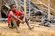 A boy sits on the ground in the village of Popoko, Bas-Sassandra region, Cote d'Ivoire, on Sunday March 4, 2012.