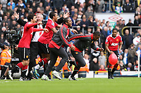 Football - Premier League - Blackburn Rovers vs. Manchester Utd<br /> Alex Ferguson, manager of Manchester United celebrates as his side rush the pitch following securing their 19th title at Ewood Park