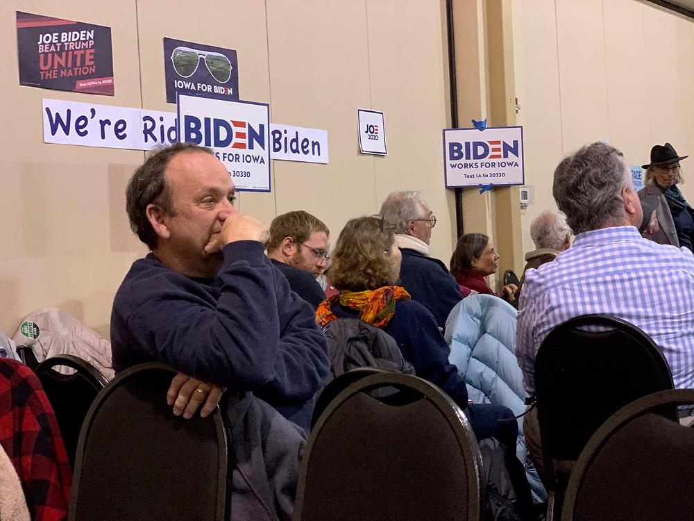 Joe Biden supporter awaits the first round of Iowa caucus results in Fairfield, Iowa