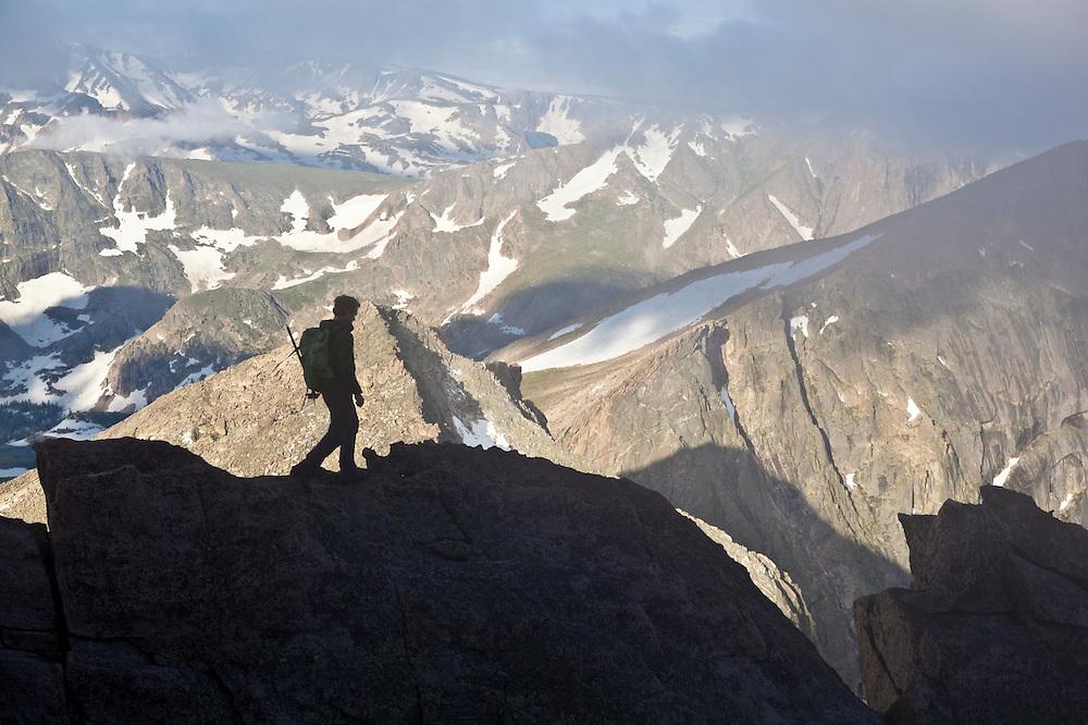 James Meldrum hikes a ridge along the Trough, Keyhole Route, Longs Peak, Rocky Mountain National, Park. Colorado.