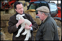 David Cameron visits a farmer in his Constituency in Oxfordshire, UK, Friday February 19, 2010. Photo By Andrew Parsons / i-Images.