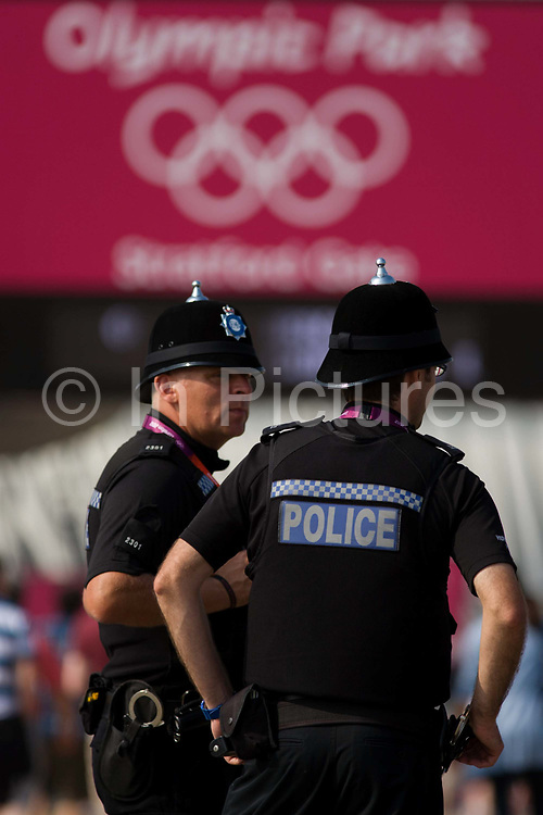 """Police officers from Humberside in the North east of England stand in front of the main entrance to the Olympic Park as a visible presence during the London 2012 Olympics. More than 230 officers from across the Humber region travelled to London to help police the Olympic Games. Holidays were restricted, training reduced and special constables  drafted in to provide cover in Hull and the East Riding as officers were sent to London to police the city while the Games are on. Senior officers say they have been working hard to ensure """"core policing"""" across Hull and the East Riding is not weakened."""