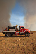 Volunteer firemen try to contain the Legacy brush fire outside of Big Spring Texas.The Legacy first burned for two days and destroyed 5000 acres before it was contain   The Drought in Texas will have long term environmental and finical impact.