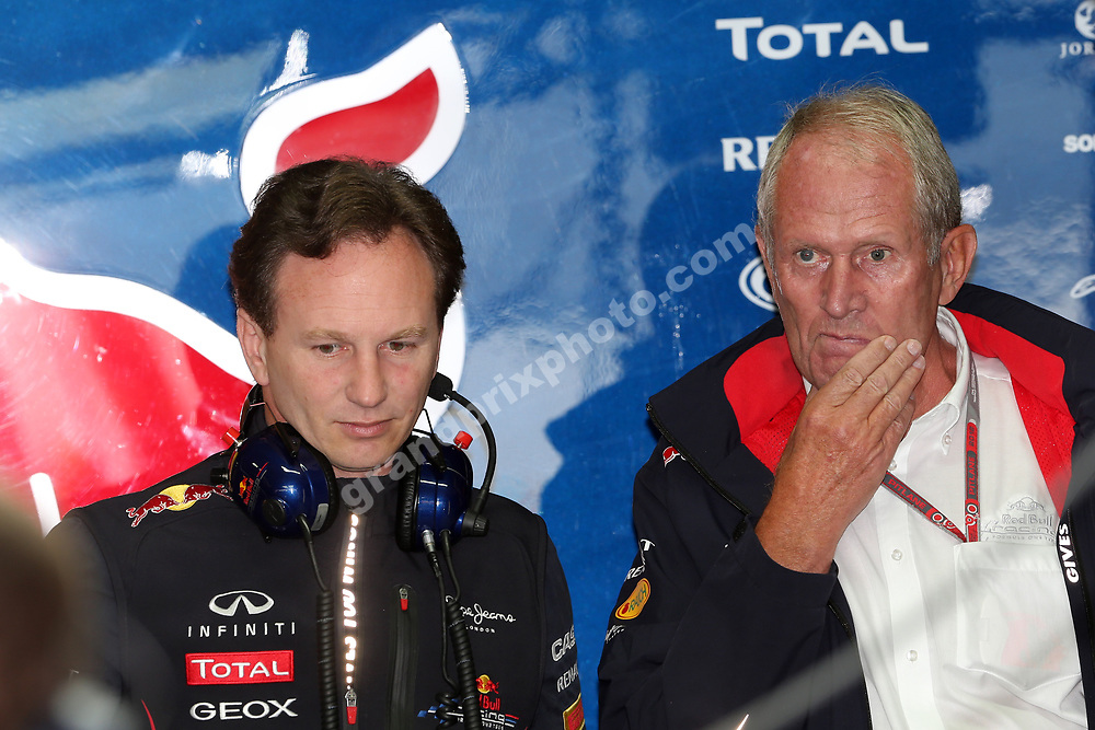 Red Bull-Renault team principal Christian Horner and Helmuth Marko in the pits during practice for the 2012 German Grand Prix in Hockenheim. Photo: Grand Prix Photo