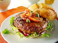 Beef burgers in a bread bun with salad & garnish