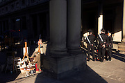 Artist paints for tourists and Carabinieri officers patrol in Florence's Piazza degli Uffizi..