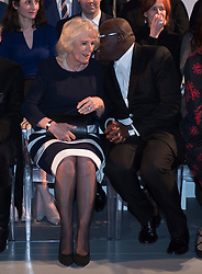 The Duchess of Cornwall (left) chats with British Vogue Editor Edward Enninful on the front row during a visit to London Fashion Week at the BFC Show Space, London.