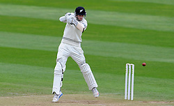 New Zealand's Mitchell Santner drives the ball. Photo mandatory by-line: Harry Trump/JMP - Mobile: 07966 386802 - 10/05/15 - SPORT - CRICKET - Somerset v New Zealand - Day 3- The County Ground, Taunton, England.