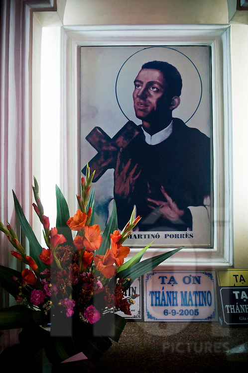 religious icon of Martino Porres on a wall of church in Ho Chi Minh city, Vietnam, Asia