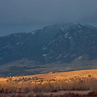Sunlight illuminates the Story Hills, between Bozeman, Montana and the Bridger Mountains.