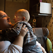 """CAPTION: Svetlana uses the Short Break service provided by Partnership for Every Child (P4EC). She did so recently as a means of crisis intervention when her mother fell and broke both her arms. Carer Maria came to the house to look after Lev, while Svetlana cared for her mother. """"Whenever mothers of other disabled children call me in despair, I tell them about the short break service"""", Svetlana says. LOCATION: St Petersburg, Russia. INDIVIDUAL(S) PHOTOGRAPHED: Svetlana Guseva (mother) and Lev Gusev (son)."""