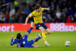 Cardiff City's Sean Morrison (floor) and West Bromwich Albion's Adam Reach battle for the ball during the Sky Bet Championship match at the Cardiff City Stadium, Cardiff. Picture date: Tuesday September 28, 2021.