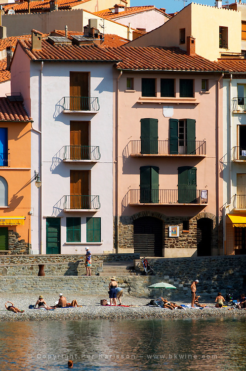 The beach in the village. Colourful houses along the water. Collioure. Roussillon. Typical village houses. France. Europe.