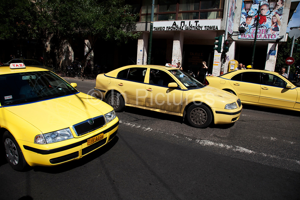 Yellow taxis on the streets of Monastiraki. Regardless the brand and type of the car, taxis in Athens are all bright yellow. There are about 14.000 taxis in total Average every taxi is operational 19 hours per day driving 350 km. Every day taxis in Athens drive about 500.000 kilometers totaling up to 1.8 million kilometers a year. Taxis in Athens are cheap which accounts for the high number of kilometers yearly. One could say the Athens taxis have their own set of rules which aren't always legal. If you want to catch a taxi in the street, you often will have to shout your destination to the driver as he drives by. If he is not going your direction, he may not stop to pick you up. This is standard practice in Athens and not regarded upon as rude. Just flag the next taxi you see. Athens is the capital and largest city of Greece. It dominates the Attica periphery and is one of the world's oldest cities, as its recorded history spans around 3,400 years. Classical Athens was a powerful city-state. A centre for the arts, learning and philosophy.