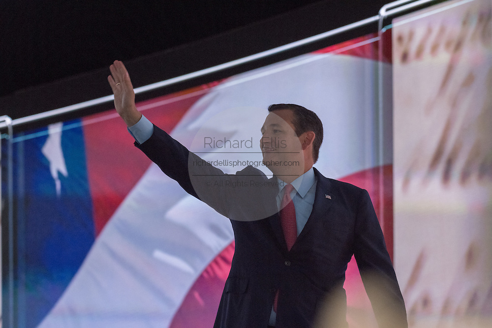 Senator Ted Cruz walks off stage in the dark after being cut off by officials during his addresses during the third day of the Republican National Convention July 20, 2016 in Cleveland, Ohio. Cruz spoke without endorsing Republican Presidential candidate Donald Trump and told delegates to vote with the conscience.
