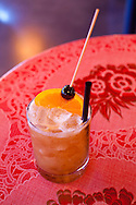 """The Whiskey Soda Lounge in Portland, Oregon's SE Neighborhood serves up aahaan kap klaem, the drinking food of Thailand, and the same drinks menu as its mother restaurant, Pok Pok. One of the lounge's signature drinks, """"Tamarind Whiskey Sour"""" with tamarind, lime juice, palm sugar and bourbon served on the rocks."""