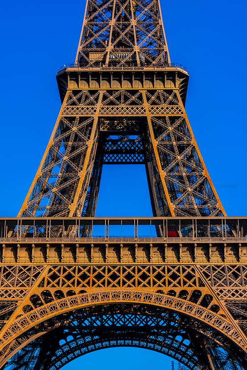 Architectural detail of the Eiffel Tower. It is the world famous wrought-iron lattice tower that is the most famous landmark of Paris, France.