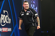 Michael Smith celebrates winning the fourth set against Mervyn King during the William Hill World Darts Championship at Alexandra Palace, London, United Kingdom on 23 December 2016. Photo by Shane Healey.