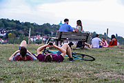 People take pictures of themselves as they enjoy the hot weather in the Hampstead Heath Park in Northwest London on Friday, Aug 7, 2020, as the UK could see record-breaking temperatures with forecasters predicting Friday as the hottest day of the year. Exceptionally hot weather is set to continue in parts of the UK throughout the weekend, the Met Office said. The highest temperatures are expected in England and Wales, with a fresher weather forecast for Scotland and NI. (VXP Photo/ Vudi Xhymshiti)