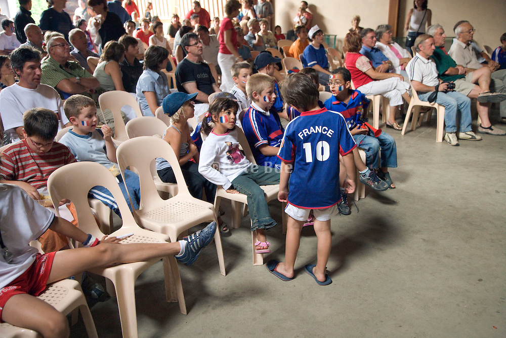 French children and adults watching a football match France-Italy World Cup 9 July 2006