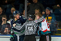 KELOWNA, CANADA - JANUARY 30:  Tyler Carpendale #14 of the Seattle Thunderbirds gets in the face of Kaedan Korczak #6 of the Kelowna Rockets as linesman Cody Wanner intervenes on January 30, 2019 at Prospera Place in Kelowna, British Columbia, Canada.  (Photo by Marissa Baecker/Shoot the Breeze)