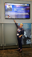 Crystal Guerrette pointing out her military history at The Women's Memorial, Washington DC. On Honor Flight Maine.