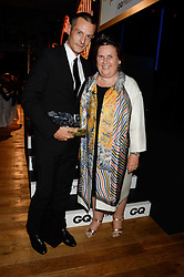 JONATHAN SAUNDERS winner of the Breakthrough Menswear Designer Brand of The Year Award and SUZY MENKES at the GQ Men of The Year Awards 2013 in association with Hugo Boss held at the Royal Opera House, London on 3rd September 2013.