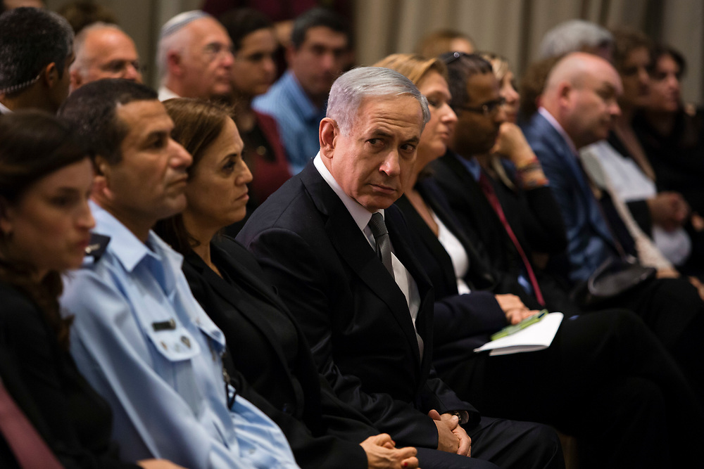Israeli Prime Minister Benjamin Netanyahu (C) and Israeli Minister of Justice Tzipi Livni (R behind Netanyahu) attend an award ceremony honoring those in the fight against human trafficking, at the President's Residence in Jerusalem, Israel, on December 2, 2014. Israel appears to be heading towards an early election after Prime Minister Netanyahu fired ministers Livni and Lapid from his coalition government having failed to patch up differences.