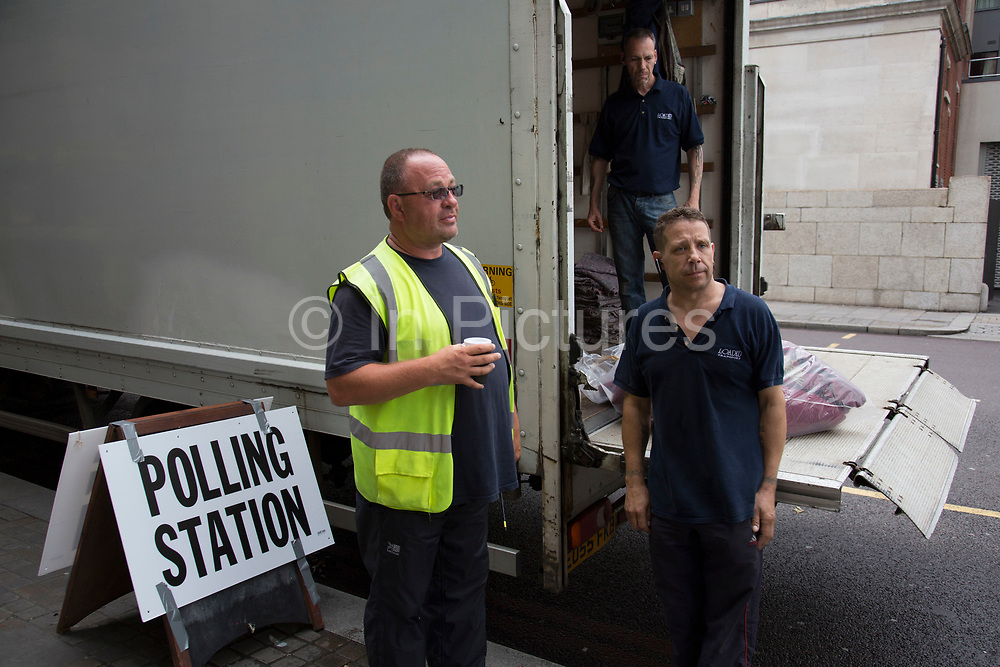 Workmen outside the polling station at Shoreditch Town Hall during the UK's EU Referendum Polling Day on June 23rd 2016 in London, United Kingdom. Membership of the European Union has been a topic of debate in the UK since the country joined the EEC, or Common Market in 1973. It will be the second time the British electorate has been asked to vote on the issue of Britain's membership: the first referendum being held in 1975, when continued membership was approved by 67% of voters. The two sides are the  Leave Campaign, commonly referred to as a Brexit, and those of the Remain Campaign who are also known as the In Campaign. (photo by Mike Kemp/In Pictures via Getty Images)