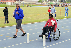 Judge and young child with disability taking part in Mini games sports event held at Stoke Mandeville Stadium,