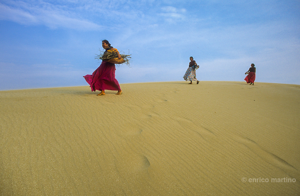 Isthmus of Tehuantepec, San Mateo del Mar. Huaves women walking on the top of sand dunes.