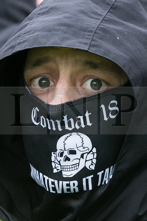 © Licensed to London News Pictures . 30/01/2016 . Dover , UK . A Combat 18 far right protester at the demonstration . Demonstrations by far-right groups (including The National Front , The North West Infidels and The South East Alliance ) and , opposing them , anti-fascists , close to the port of Dover in Kent . Photo credit : Joel Goodman/LNP